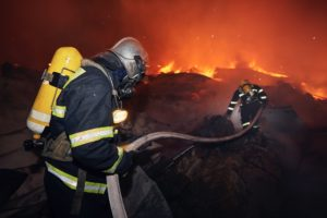 Firefighters during extinguishing fire of building